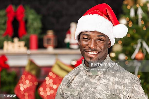 soldier celebrating christmas at home - army christmas stock pictures, royalty-free photos & images