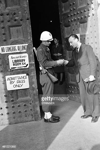 Soldier checks a visitor at the entrance of the Palace of Justice in Nuremberg where the International Military Tribunal tried Nazi leaders in 1946....