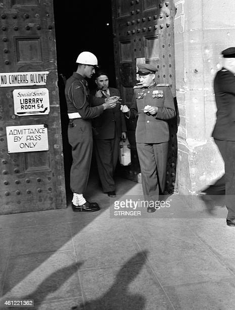 US soldier checks a visitor at the entrance of the Palace of Justice in Nuremberg where the International Military Tribunal tried Nazi leaders in...