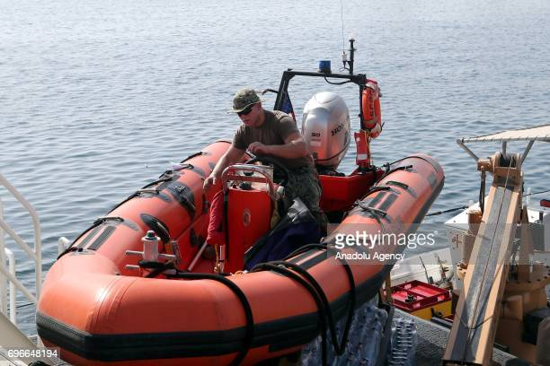 A soldier checks an inflatable boat at Hamad Port for a joint naval exercise with Qatar navy in Doha Qatar on June 16 2017 After 12 billion dollars...