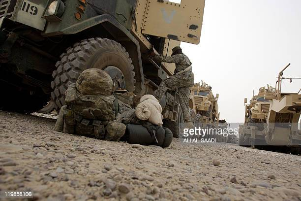 US soldier climbs out of a cab of a US military lorries on July 23 at Contingency Operating Base Speicher on the outskirts of Tikrit 160 kilometres...