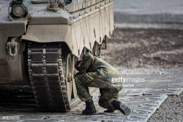 Soldier controls the chainring of a tank. Shot during an exercise of the land forces on October 13, 2017 in Munster, Germany.