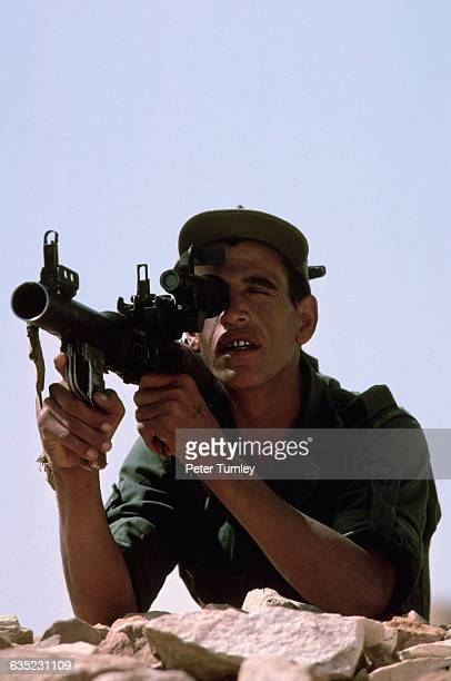 A soldier defends the southern Moroccan defense wall erected during Morocco's conflict with the Polisario Front over this western area of the Sahara