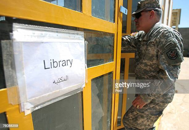 S soldier enters in the library during the opening of Dar AlHikmah a juvenile detainee education facility at the US military Camp Victory August 14...