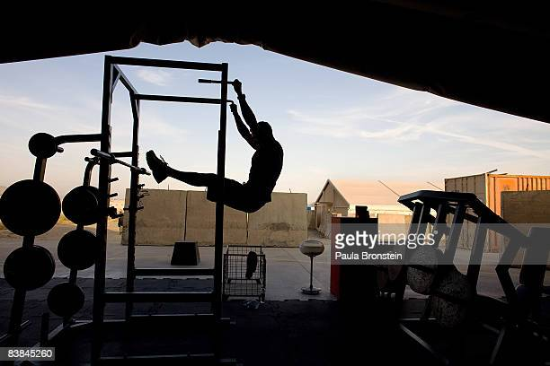 US soldier exercises at the gym after enjoying a special Thanksgiving meal at the US military forward operating base Camp Salerno near Khost on...