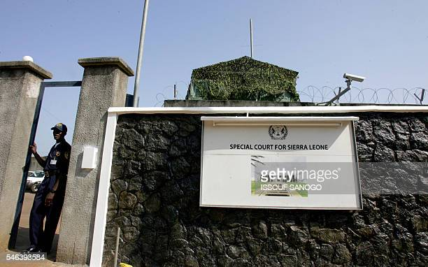 A soldier exits the United Nations mission to Sierra Leone stands guard 31 March 2006 in front of the gate of the Special Court for Sierra Leone in...