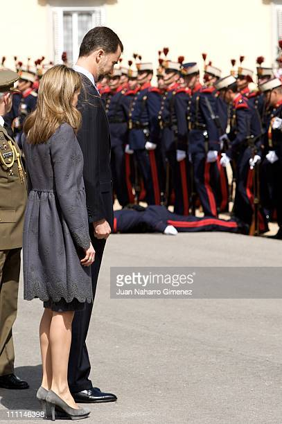 A soldier faints in the guard of honour during the visit of the Prince Charles Prince of Wales and his wife Camilla Duchess of Cornwall at the El...