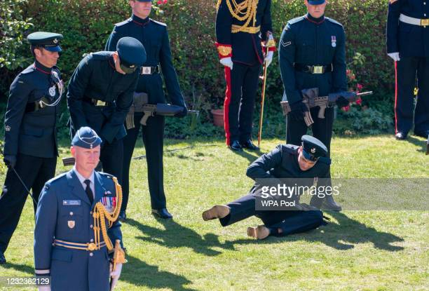 Soldier falls during the funeral of Prince Philip, Duke of Edinburgh at Windsor Castle on April 17, 2021 in Windsor, United Kingdom. Prince Philip of...