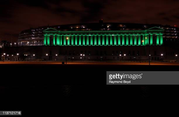 Soldier Field home of the Chicago Bears football team is illuminated in green to celebrate St Patrick's Day in Chicago Illinois on March 17 2019