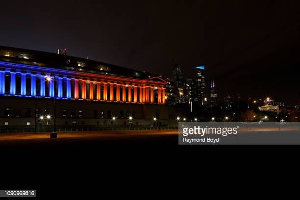 Soldier Field home of the Chicago Bears football team lights up in the Bears' blue and orange colors in support of the Chicago Bears' wild card game...