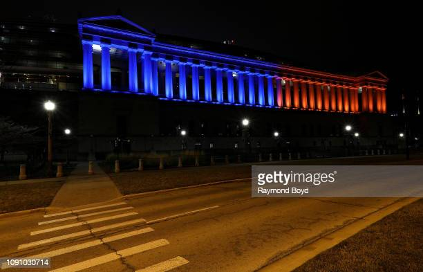 Soldier Field, home of the Chicago Bears football team lights up in the Bears' blue and orange colors in support of the Chicago Bears' wild card game...