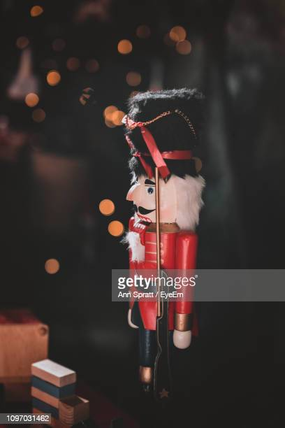 soldier figurine and toy blocks on table against defocused lights - army soldier toy stock pictures, royalty-free photos & images