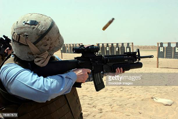 A soldier fires a weapon.