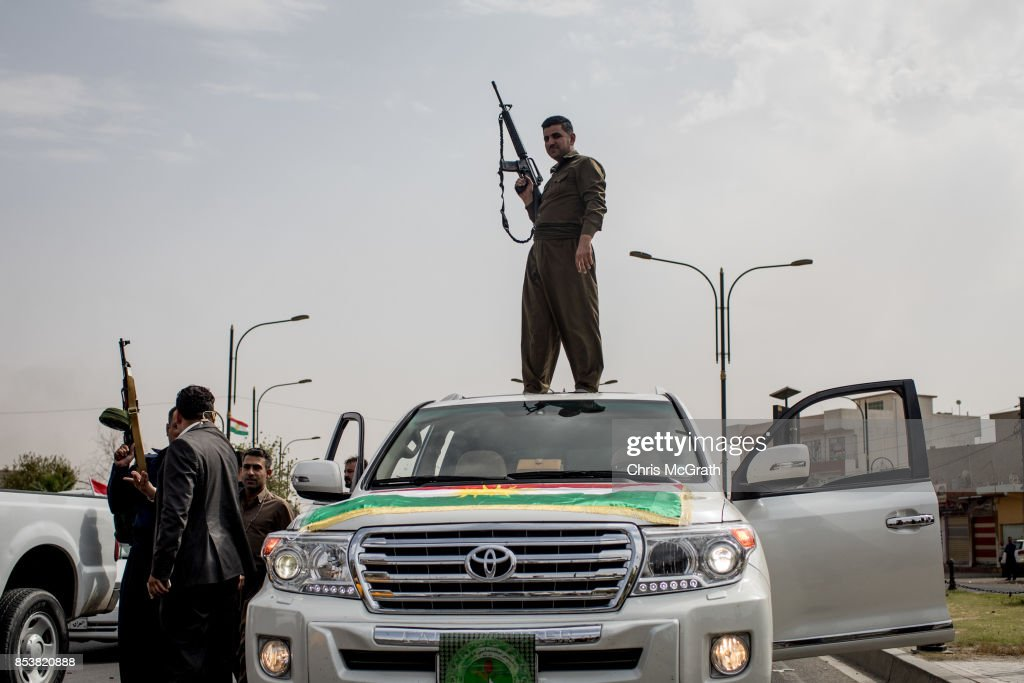 A soldier fires his gun in the air to celebrate the referendum on the road outside a voting station on September 25, 2017 in Kirkuk, Iraq. Despite strong objection from neighboring countries and the Iraqi government, some five million Kurds took to the polls today across three provinces in the historic independence referendum.