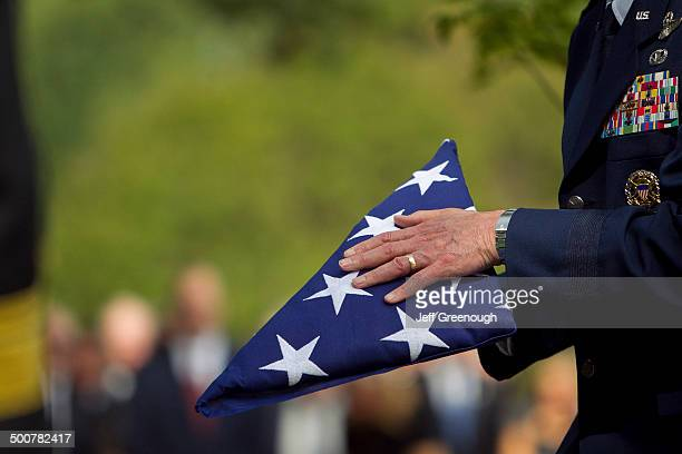 soldier folding flag at military funeral - military flags stock photos and pictures