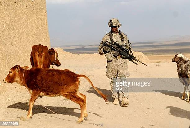 A US soldier from 1st Platoon Alpha company 3187 3BCT 101 Airbourne walks during a patrolling in Yosef Khel district of Paktika province on April 1...