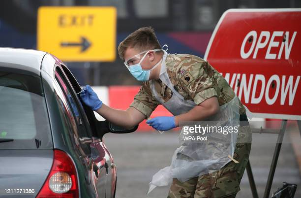 Soldier from 2 Scots Royal Regiment of Scotland takes a test sample at a Covid-19 testing centre at Glasgow Airport on April 29, 2020 in Glasgow,...
