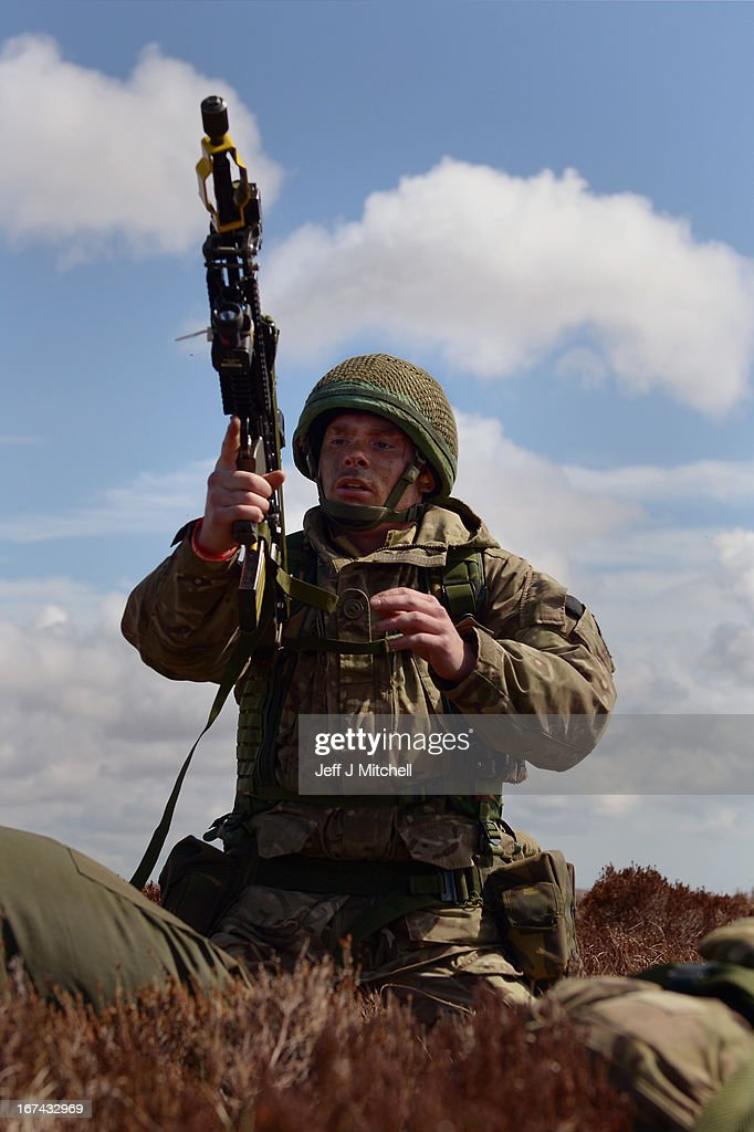 A soldier from 2nd Battalion, Parachute Regiment (2 PARA) in action during a British And French Airborne Forces joint exercise on April 25, 2013 in Stranraer, Scotland. Exercise 'Joint Warrior' sees British and French airborne forces demonstrate their readiness to be deployed together as the 'Intermediate Combined Joint Expeditionary Force' ( i-CJEF) on contingency operations, ranging from disaster relief to war fighting.