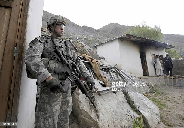 Soldier from 3rd Platoon Apache stands guard during a patrol on the outskirts of Naray in Nuristan province on April 3, 2009. The imminent deployment...