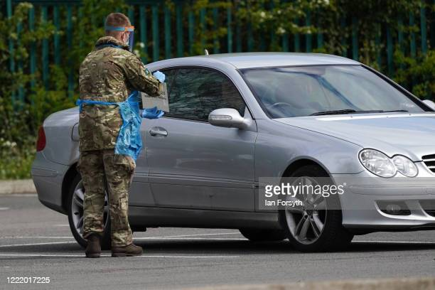 A soldier from 4 Battalion The Yorkshire Regiment holds up instructions as he oversees testing at a COVID19 selftesting facility at Darlington's...