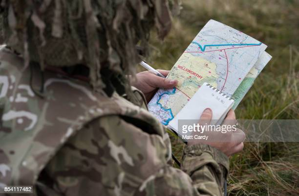 A soldier from 6 RIFLES looks at a map on the range at Okehampton Camp Dartmoor during the 6th Battalion The Rifles' Annual Deployment Exercise near...