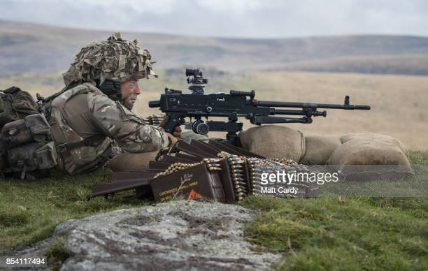 Soldier from 6 RIFLES prepares to fire live ammunition from a General Purpose Machine Gun on the range at Okehampton Camp, Dartmoor, during the 6th...