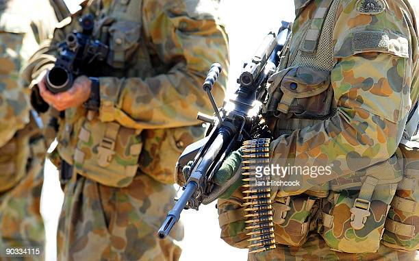 A soldier from an infantry section carries his 556mm minimi machine gun during an Army fire power demonstration at Range Control High Range on...