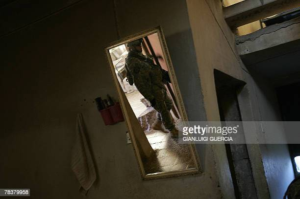A US soldier from Bravo company 1st Battalion 38 regiment infantry is reflected in a mirror as he searches a house during a patrol in West Baquba 10...