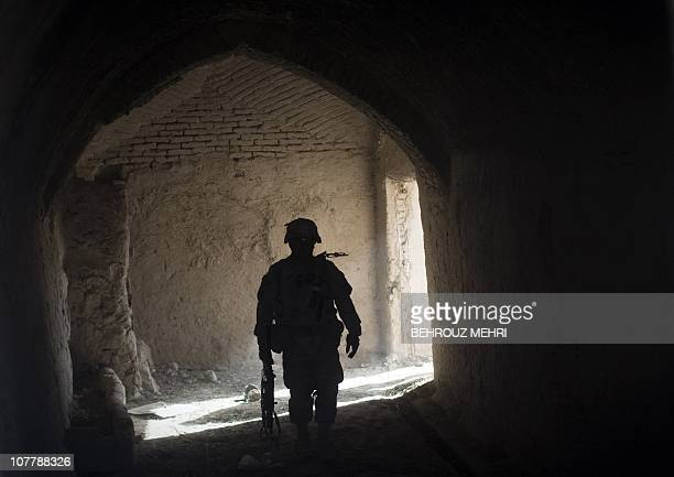 A US soldier from Bravo Troop 175 Cavalry 2nd Brigade 101st Airborne Division enters an abondoned house in Haji Ghaffar village during a clearance...