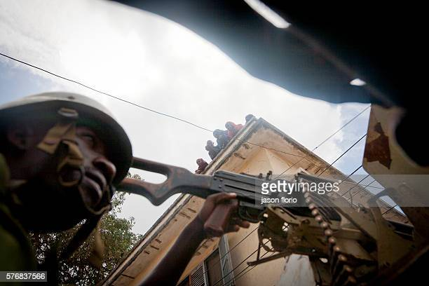 A soldier from Burundi who is part of AMISOM African Union Mission in Somalia watches from the open roof of a Casspir armored vehicle on a patrol...
