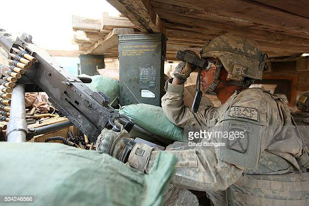 A soldier from Charlie Company US Army 10th Mountain Division watches the hillside at Firebase Lindstrom Barge Matal Nuristan Province