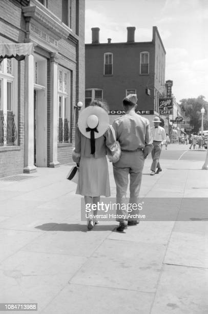 Soldier from Fort Benning and Girlfriend Walking down Sidewalk, Columbus, Georgia, USA, Jack Delano, Office of War Information, May 1941.