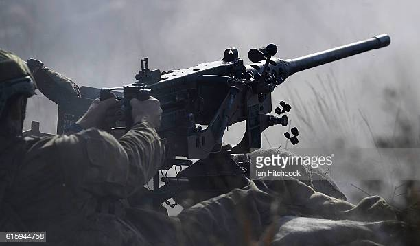 A soldier from the 1 RAR Heavy Weapons Platoon fires a 50 calibre machine gun during the 3rd Brigade Live Fire Exercise 'Brolga Run' on October 21...