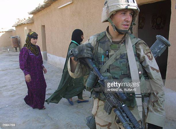 Soldier from the 101st Airborne Division, Alpha company, leaves a house in the village of Alaiba, 70 kms southwest of the northern Iraqi city of...