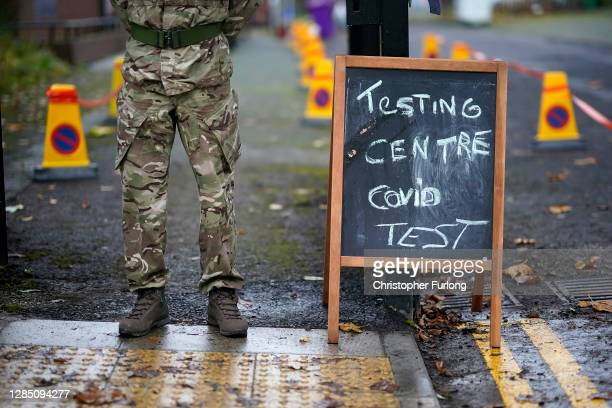 Soldier from the 1st battalion Coldstream Guards greets members of the public at a coronavirus testing centre set up at the Merseyside Caribbean...