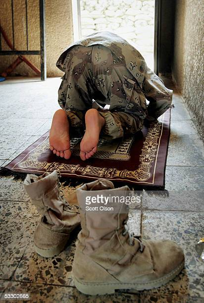 A soldier from the 1st Battalion of the Iraqi Ground Forces Command prays in an abandoned school which has been converted into a barrack July 29 2005...