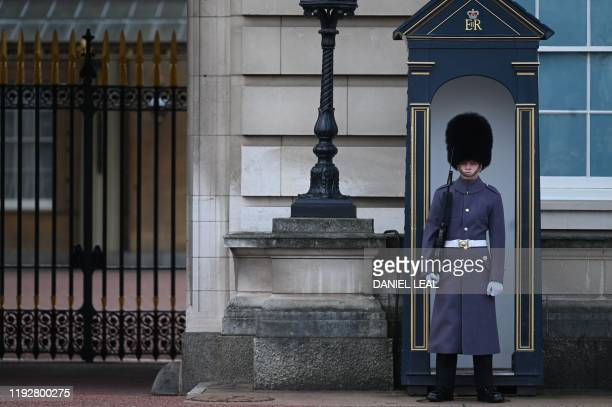 Soldier from the 1st battalion Welsh Guards stands guard outside Buckingham Palace in London on January 10, 2020. - Prince Harry's wife Meghan has...