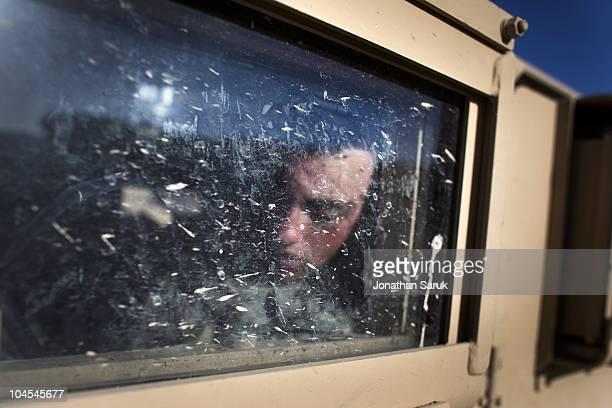 US soldier from the 3rd Brigade 10th Mountain Division sleeps in a Humvee at the Jaghatu District Center May 12 2009 in Jaghatu District Wardak...
