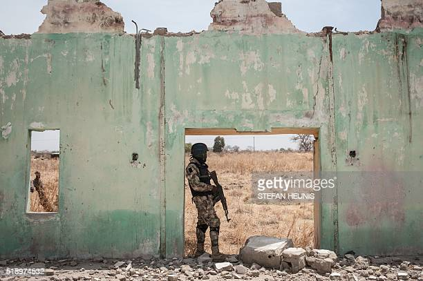 A soldier from the 7th Division of the Nigerian Army stands amidst the ruin of the Government Girls Secondary School Chibok in Borno State...