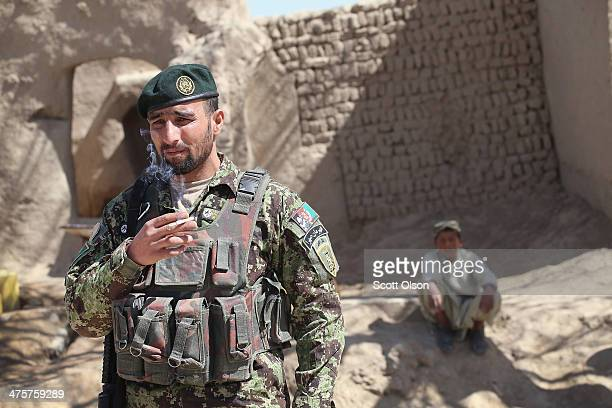 A soldier from the Afghan National Army walks through a village during a joint patrol with the US Army's 4th squadron 2d Cavalry Regiment on March 1...