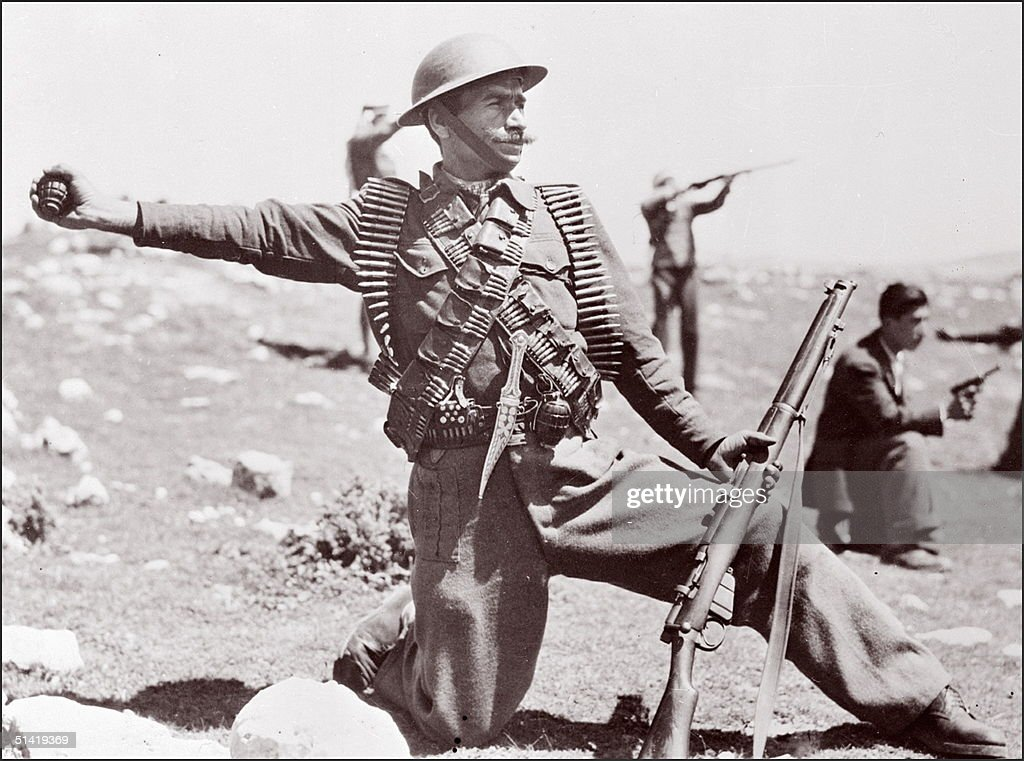 A soldier from the Arab Legions for Palestine wearing a British-made helmet and holding a British-made Enfield rifle, throws a grenade to the Israeli positions in May 1948 near Hebron while his army comrades shoot. As independence of the state of Israel was declared, 14 May 1948 at Tel Aviv, Arab forces from Egypt, Syria, Transjordan (later Jordan), Lebanon, and Iraq invaded Israel on 14 May 1948.