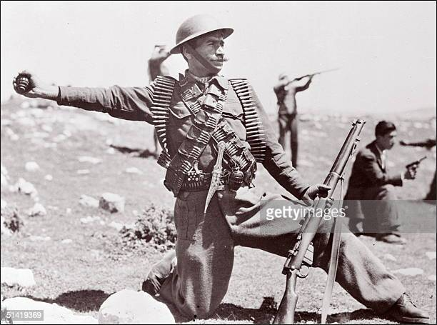 Soldier from the Arab Legions for Palestine wearing a British-made helmet and holding a British-made Enfield rifle, throws a grenade to the Israeli...