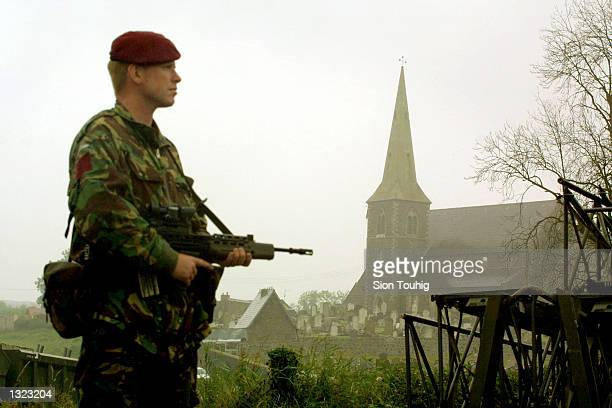 A soldier from the British Army Parachute Regiment guards the perimeter around Drumcree Church on the eve of the controversial Orange Order parade...