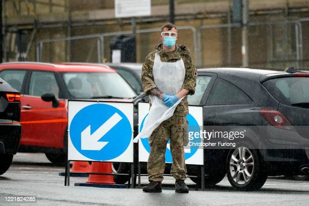 Soldier from the Duke of Lancaster's Regiment, instructs people arriving at a pop-up mobile Covid-19 testing centre on April 29, 2020 in...