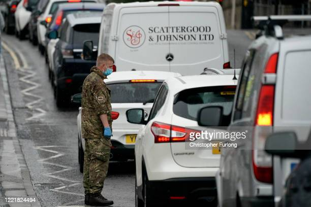 A soldier from the Duke of Lancaster's regiment instructs people in the traffic queue at a popup mobile Covid19 testing centre on April 29 2020 in...