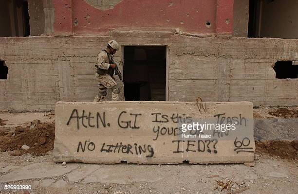 A soldier from the Fighting 69 a New York National Guard unit inspects an abandoned building close to Route Irish the high profiled highway between...