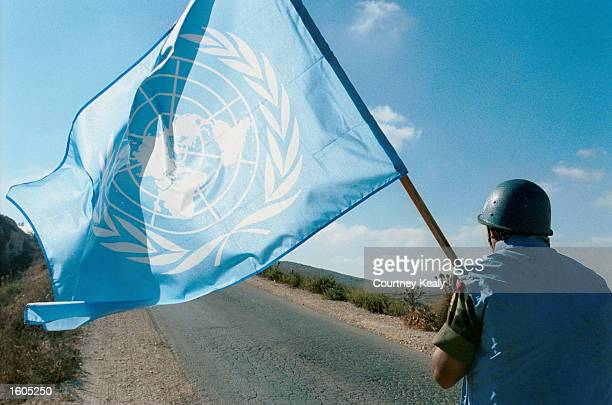 A soldier from the Indian Battalian of the United Nations Peacekeeping Force of Lebanon patrols along the border with Israel and Syria in an effort...