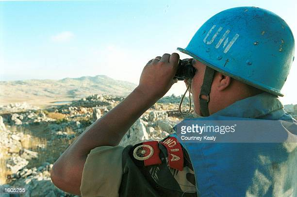 Soldier from the Indian Battalian of the United Nations Peacekeeping Force of Lebanon patrols along the border with Israel and Syria in an effort to...
