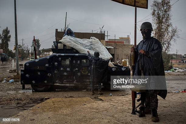 A soldier from the Iraqi Federal police stands guard outside the Mar Hanna church during Christmas day mass in Qaraqosh on December 25 2016 in Mosul...