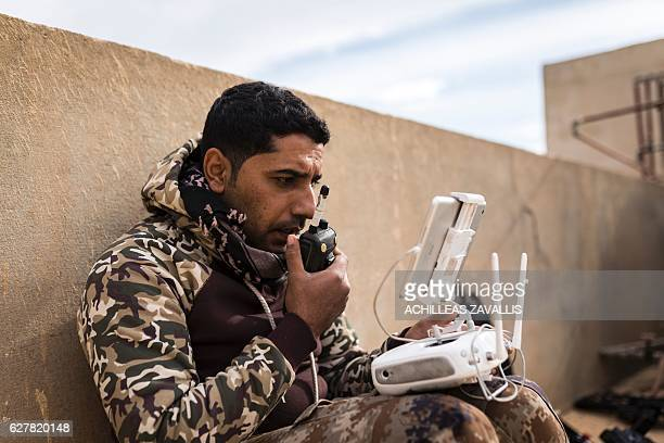 TOPSHOT A soldier from the Mosul Brigade of the Iraqi Special Operations Force 2 operates a drone during a military advance to retake parts of the...